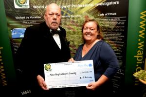 WAPI Chairman John Edwards presenting Alder Hey Representative, Irene Axon, with the cheque